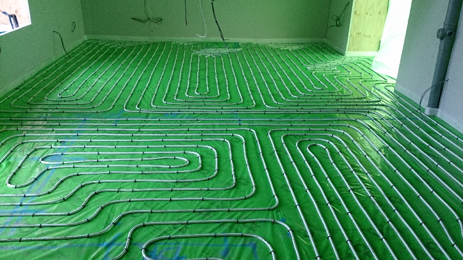 A moisture barrier is required to keep the floor screed separated from the foiled insulation.  Otherwise the screed will dissolve the aluminium foil.  This is also known as separation layer and vapour barrier.